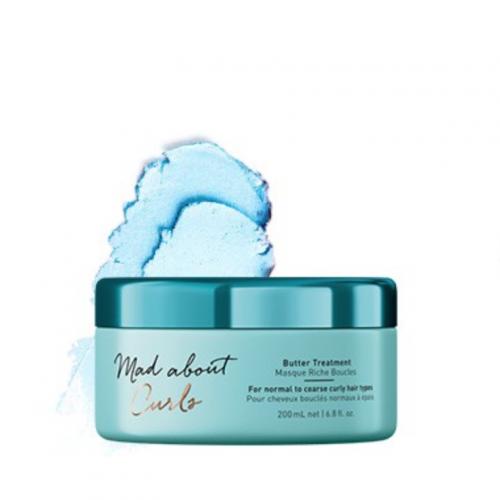 Mad Abour Curls Máscara Intensiva é um tratamento intensivo para o cabelo. Sua fórmula nutre profundamente e hidrata o cabelo. Ela também doma o frizz, proporciona brilho e fortalece o cabelo.
